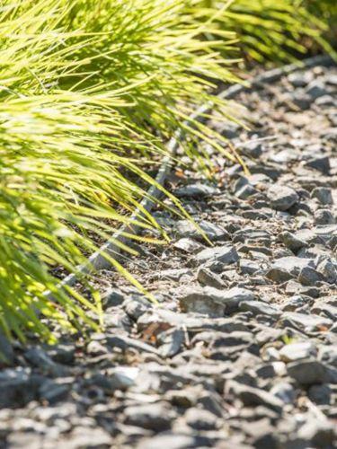 Tuinafboording Ecolat rol grijs aangelegd